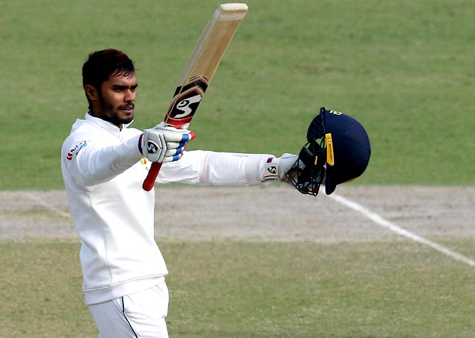 Sri Lanka's Dhananjaya de Silva celebratesd on completing a century in the 3rd Test against India at the Feroz Shah Kotla Stadium in New Dehli on Wednesday