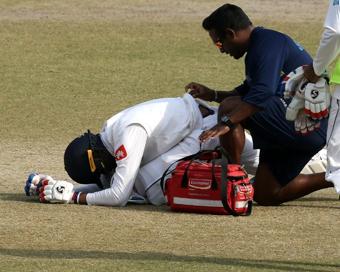 Dhananjaya de Silva receives treatment from the team physio