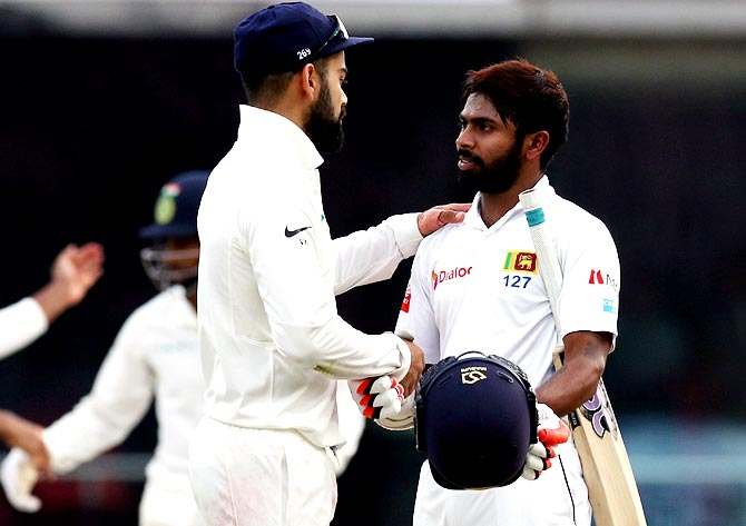 Virat Kohli greets Nirohan Dickwella at the end of the match