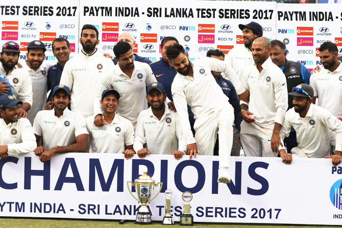 India captain Virat Kohli and members of the Indian cricket team at the post-match presentation ceremony after India drew the 3rd Test against Sri Lanka in New Delhi to claim the Test series 1-0