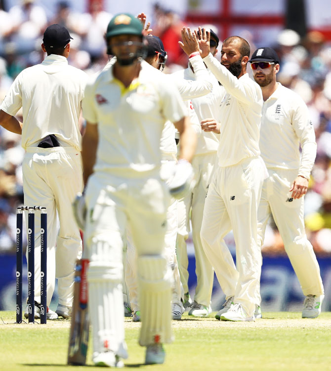 England's Moeen Ali celebrates after taking the wicket of Australia's Shaun Marsh