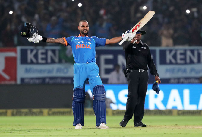 Shikhar Dhawan celebrates on completing his century