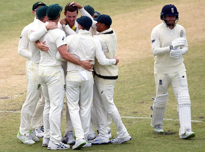 Australia's players celebrate as Jonny Bairstow walks back after his dismissal