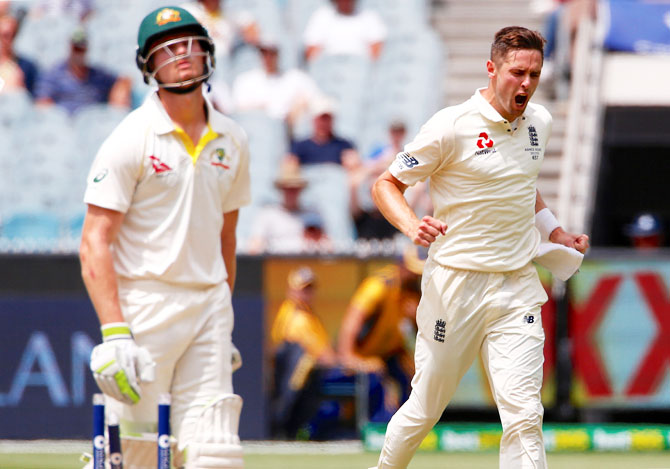 England's Chris Woakes reacts after bowling Australia's Cameron Bancroft