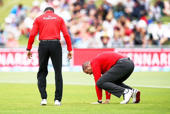 Umpires Kumar Dharmasena and Chris Brown check the playing surface at McLean Park in Napier, New Zeland on Thursday