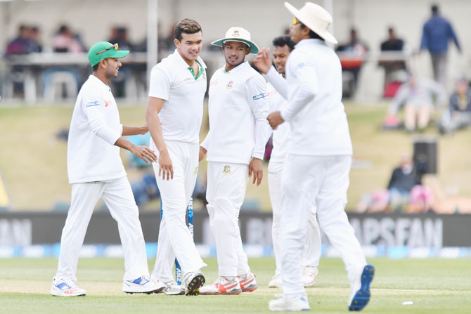 Bangladesh's Taskin Ahmed is congratulated by teammates after dismissing New Zealand's Tom Latham during their recently concluded Test series on January 21, 2017 in Christchurch, New Zealand.