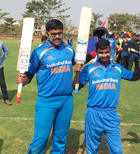 Players of India's blind cricket team celebrate