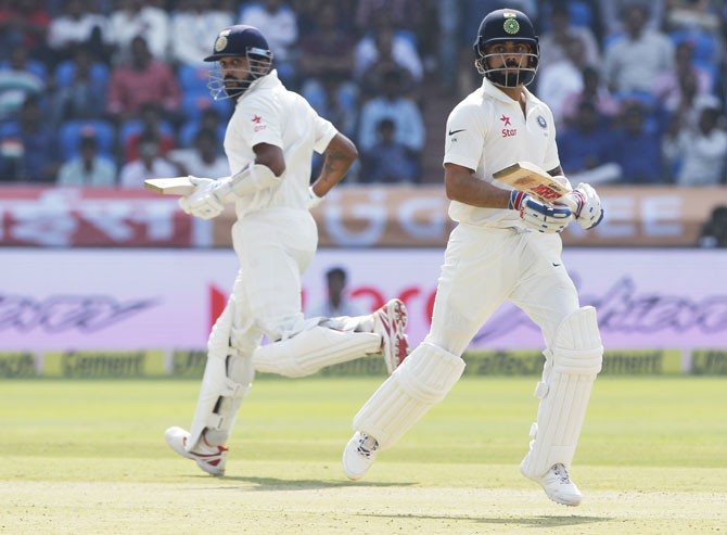 Vijay  India's Virat Kohli and Murali Vijay jog between wickets