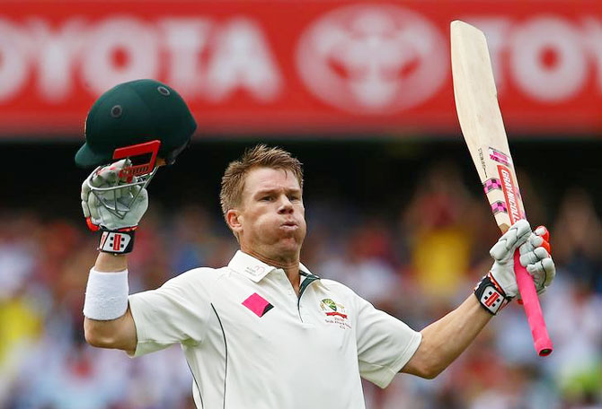 Rediff Cricket - Indian cricket - PHOTOS: Warner sparks fireworks in record time