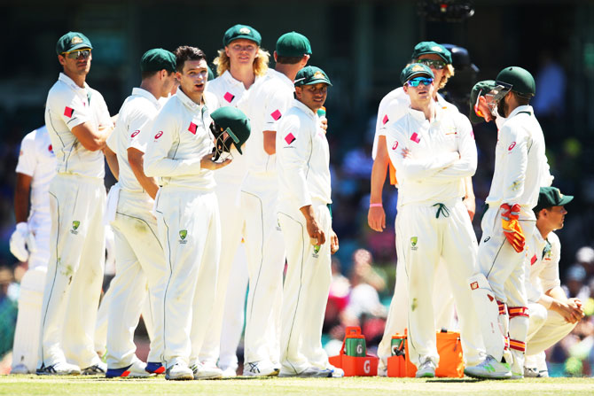 Australia players await a DRS decision on Day 5 of the 3rd Test against Pakistan on Saturday. Australia will travel to India with more or less the same bunch of players that played the series clean sweep over Pakistan