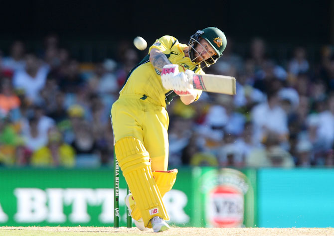 Australia's Matthew Wade hits the ball over the boundary for a six during the first game of the One Day International series against Pakistan at The Gabba in Brisbane on Friday
