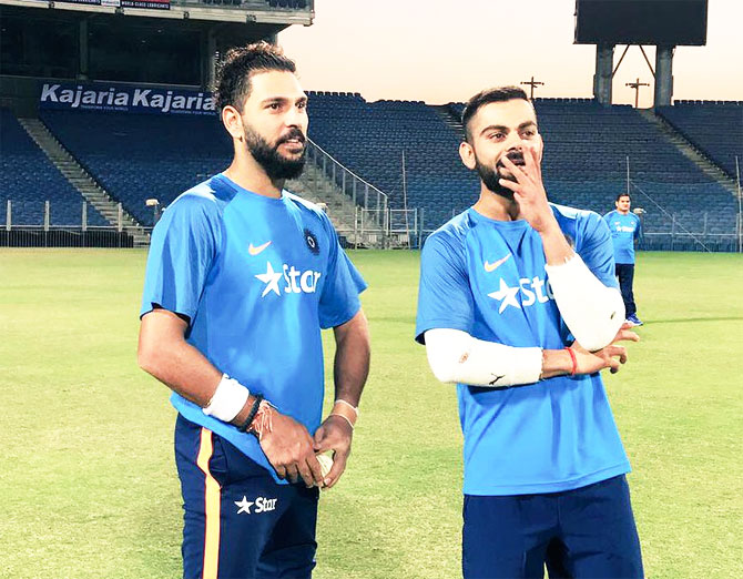 Yuvraj Singh and Virat Kohli at a team training session in Pune on Wednesday