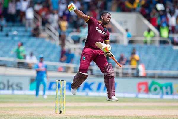 West Indies opener Evin Lewis celebrates on completing his century against India during the lone T20 at Kingston, Jamaica, on Sunday