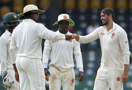 Zimbabwe captain Graeme Cramer celebrates a Sri Lankan wicket on Day 2 of the one-off Test in Colombo on Sunday