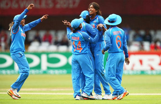 India cricketers celebrate on defeating New Zealand in their ICC Women's World Cup match in Derby on Saturday