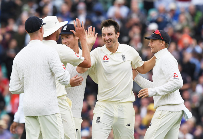 England's Toby Roland-Jones celebrates after taking his fourth wicket on Day 2 of the 3rd Investec Test against South Africa at The Kia Oval in London on Friday