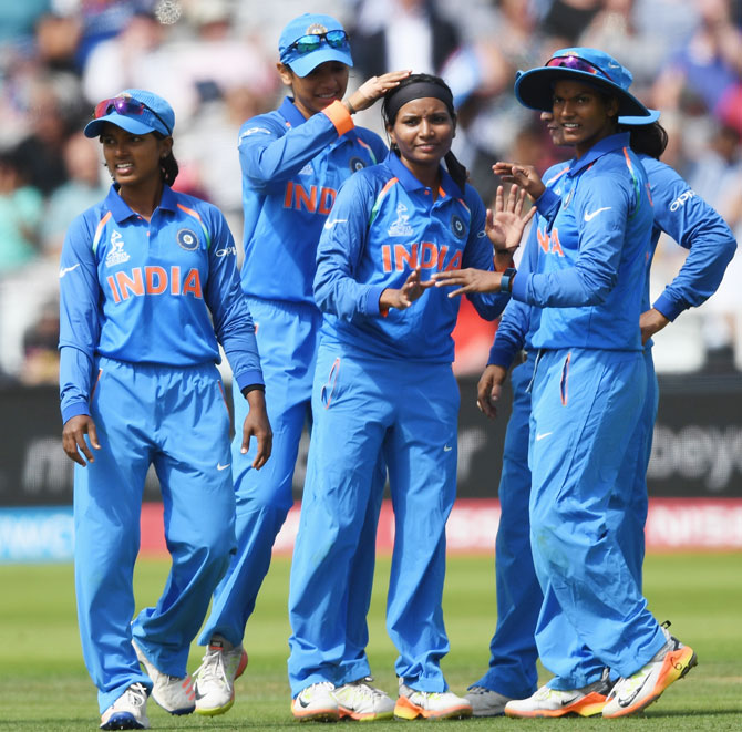 Rajeshwari Gayakwad is congratulated by team-mates after taking the wicket of England opener Lauren Winfield during the ICC Women's World Cup 2017 final at Lord's Cricket Ground in London on July 23