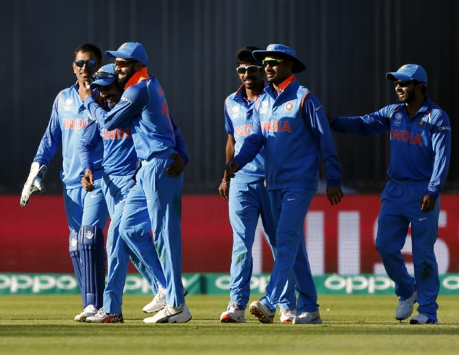 India's players celebrate the wicket of Shoaib Malik