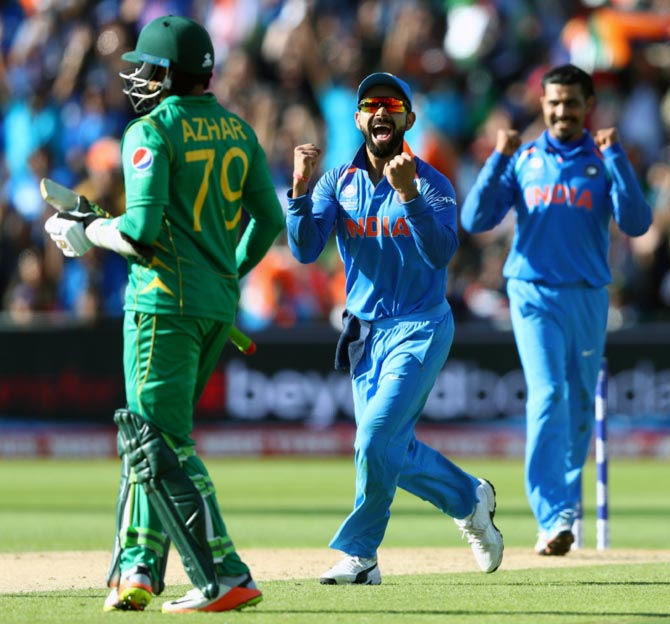 India Captain Virat Kohli and Ravindra Jadeja celebrate Azhar Ali's wicket in the opening game of last year's Champions Trophy. Photograph: Gareth Copley/Getty Images