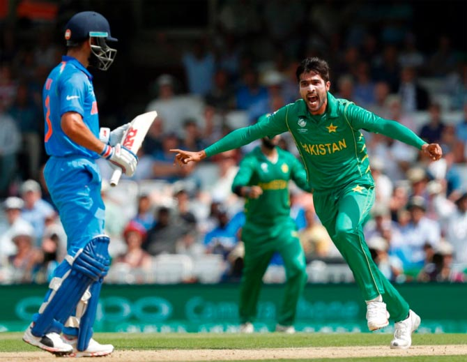 Pakistan's Mohammad Amir celebrates after claiming the wicket of India captain Virat Kohli