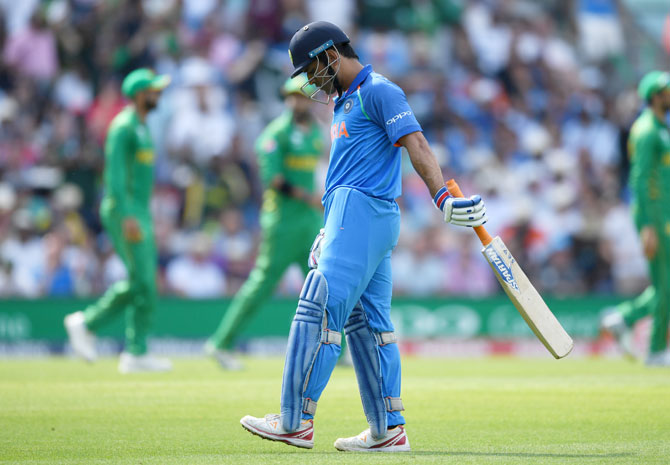 MS Dhoni leaves the field after being caught out by Imad Wasim