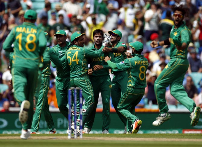 Pakistan's players celebrate the wicket of Virat Kohli during the Champions Trophy final on Sunday