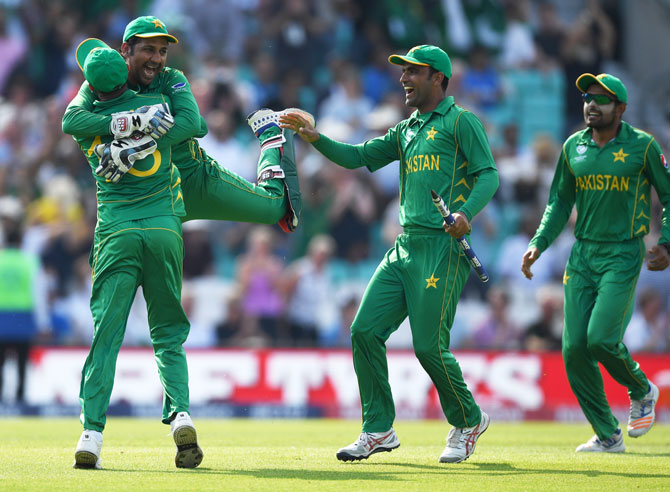 Pakistan captain Sarfraz Ahmed celebrates with Shoaib Malik after winning the ICC Champions Trophy final against India at The Kia Oval in London on Sunday