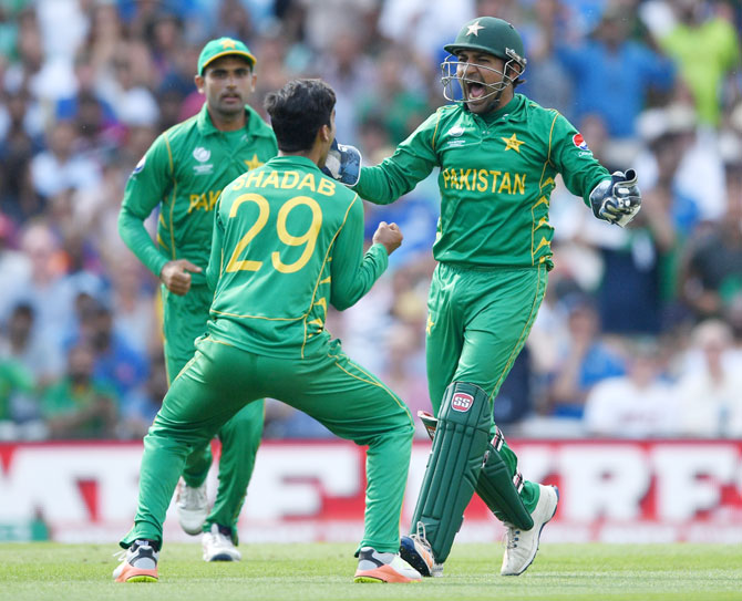 Pakistan captain and keeper Sarfraz Ahmed celebrates with Shadab Khan after catching out India's Kedar Jadhav