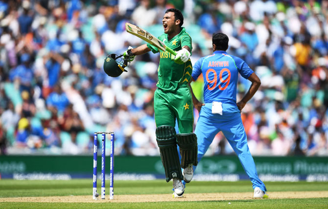 Pakistan's Fakhar Zaman celebrates reaching his century against India