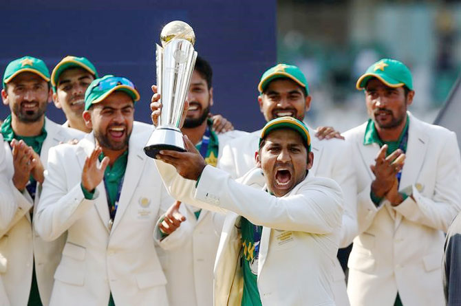 Pakistan captain Sarfraz Ahmed holds aloft the Champions Trophy as he celebrates with his team after defeating India in the final on Sunday