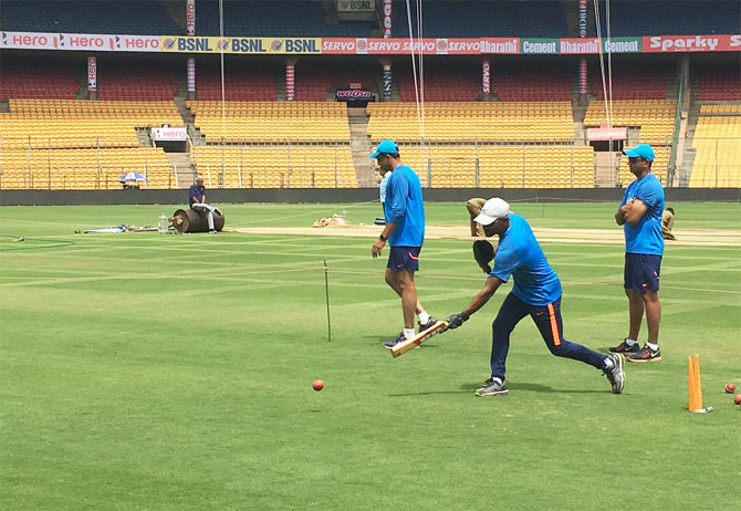 India's fielding coach R Sridhar gives the Indian players catching practice during training in Bengaluru on Thursday