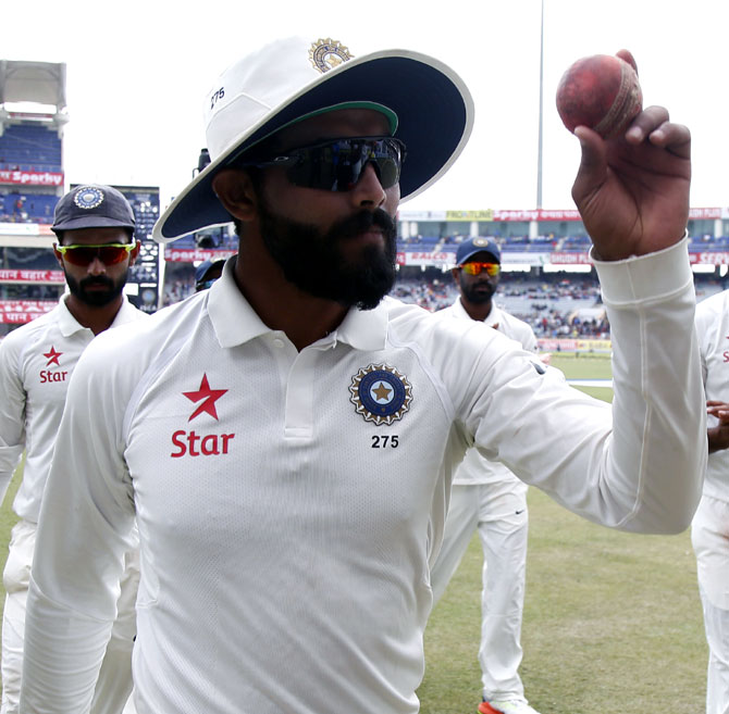Ravindra Jadeja celebrates picking up five wickets after the end of Australia's first innings