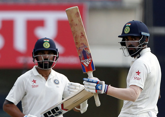 KL Rahul, right, raises his bat to the crowd after completing his half-century against Australia on Day 2 of the 3rd Test in Ranchi on Friday