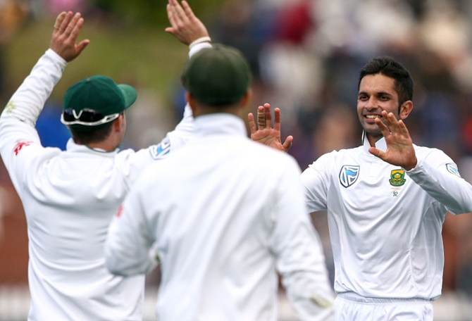 South Africa's Keshav Maharaj, right, celebrates after taking the wicket of Jeetan Patel of New Zealand at Basin Reserve in Wellington