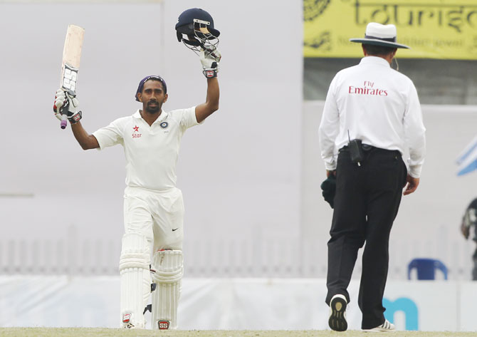 Wriddhiman Saha acknowledges the crowd after completing his century