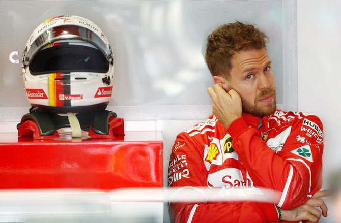 Rediff Sports - Cricket, Indian hockey, Tennis, Football, Chess, Golf - Ferrari's Vettel believes 'we can do something in the race'
