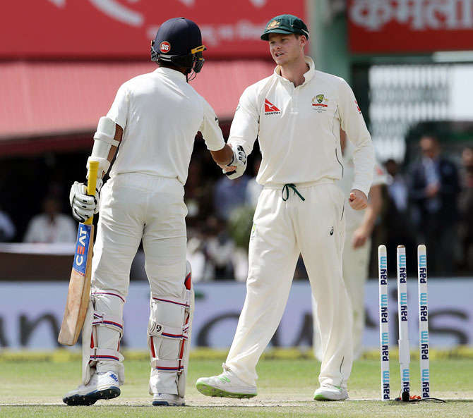 Australia captain Steve Smith, right, congratulates India skipper Ajinkya Rahane after the match on Tuesday