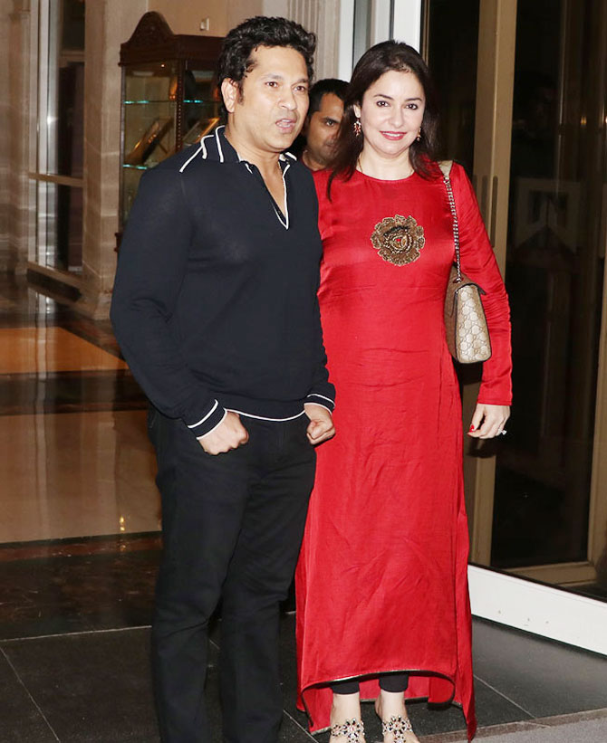 Sachin Tendulkar arrives with wife Anjali for the launch of his app '100MB' in Mumbai on Thursday