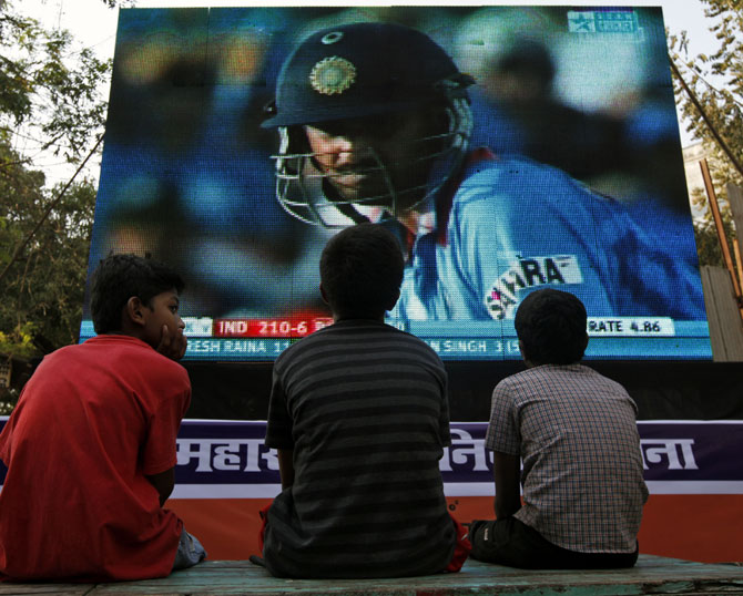 Children watch the 2011 ICC World Cup semi-final match between India and Pakistan on a big screen in Mumbai