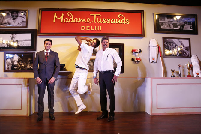 Kapil Dev (right) strikes a pose beside his wax figurine in New Delhi on Thursday