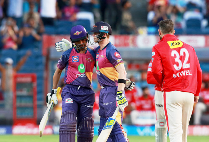 Rising Pune Supergiant's Ajinkya Rahane and Steven Smith celebrate after the win