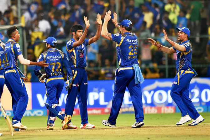 Jasprit Bumrah celebrates with teammates after dismissing Chris Lynn