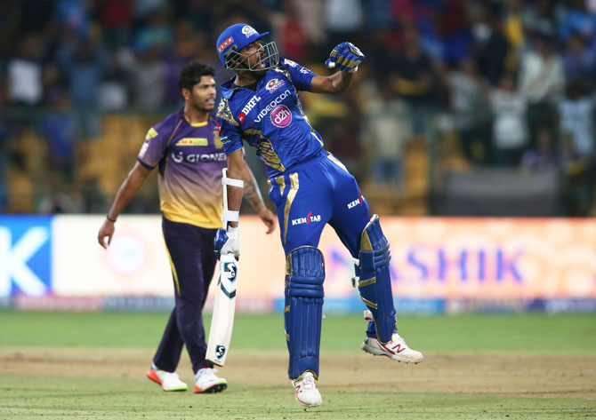 Mumbai Indians' Krunal Pandya exults after hitting the winning runs against Kolkata Knight Riders during Qualifier 2 of the Indian Premier League in Bengaluru on Friday