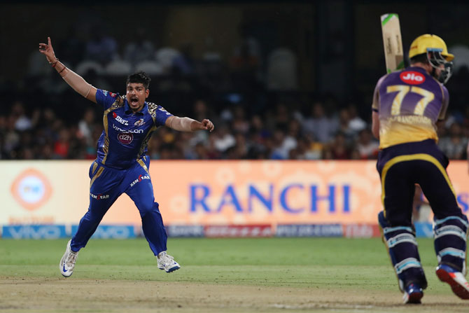 Karn Sharma celebrates after taking the wicket of Colin de Grandhomme