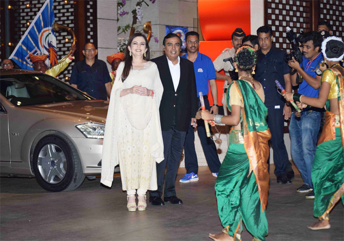 Nita and Mukesh Ambani are welcomed by 'Lezhim' dancers and musicians