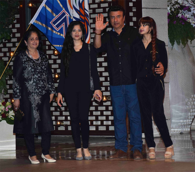 Bollywood music composer Anu Malik and his family arrive for the party