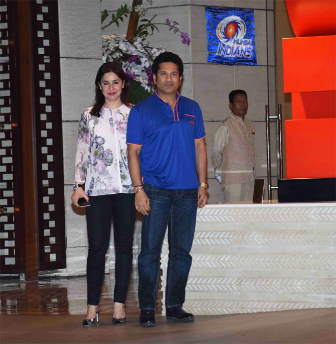 Mumbai Indians' team mentor Sachin Tendulkar and wife Anjali arrive for the party thrown by the team owners Mukesh and Nita Ambani, at a city hotel in Mumbai on Monday
