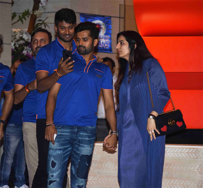 Mumbai Indians' R Vinay Kumar (right) arrives hand-in-hand with his partner