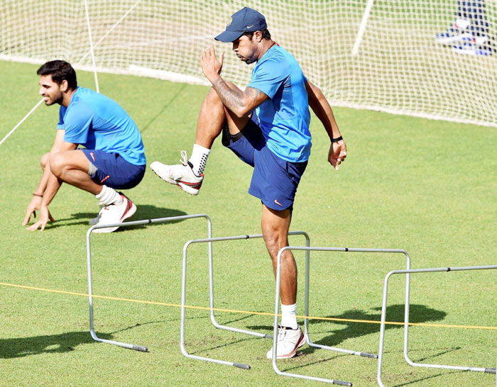 Indian pacers B Kumar and Umesh Yadav get into the groove during a training session at Eden Garden in Kolkata on Monday