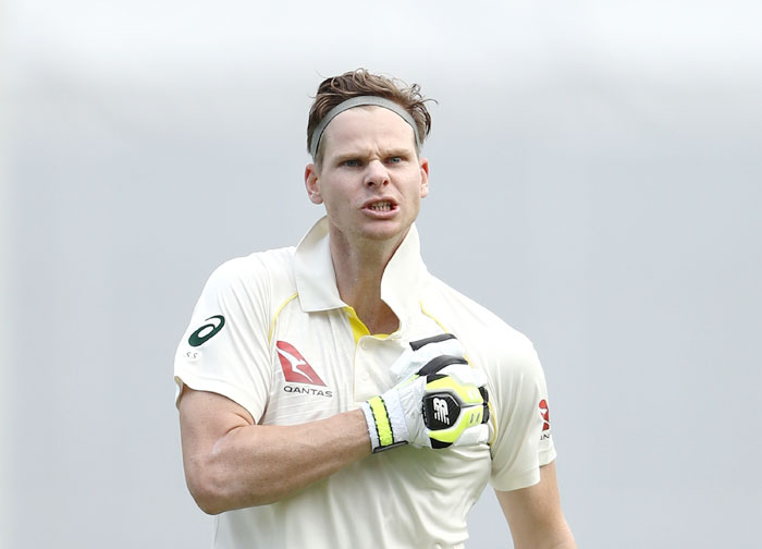 Steve Smith thumps his chest after completing his century against England in the opening Ashes Test at the Gabba in Brisbane on Saturday